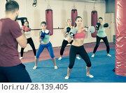 Купить «Training in a girl's group with a boxing coach», фото № 28139405, снято 8 октября 2017 г. (c) Яков Филимонов / Фотобанк Лори