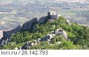 Купить «The Castle of the Moors is a hilltop medieval castle located in the municipality of Sintra, about 25km northwest of Lisbon, Portugal», видеоролик № 28142793, снято 2 мая 2017 г. (c) Алексей Кузнецов / Фотобанк Лори