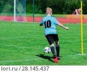 Купить «Young soccer player on the soccer field in action», фото № 28145437, снято 16 июня 2019 г. (c) easy Fotostock / Фотобанк Лори