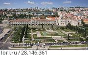 Купить «LISBON - APRIL 10: Bird eye view of Jeronimos (Hieronymites) Monastery in Lisbon  - the most grandiose monument to late Manueline Portuguese style architecture. April 10, 2017 in Lisbon, Portugal», видеоролик № 28146361, снято 10 апреля 2017 г. (c) Алексей Кузнецов / Фотобанк Лори