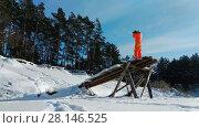Купить «Photographer using a strange wooden construction for photographing», видеоролик № 28146525, снято 13 февраля 2018 г. (c) Чебеляев Геннадий / Фотобанк Лори