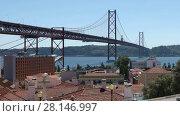 Купить «The 25 de Abril Bridge (25thof April Bridge) is a suspension bridge connecting the city of Lisbon, capital of Portugal, to the municipality of Almada on the left (south) bank of the Tagus river», видеоролик № 28146997, снято 14 июня 2017 г. (c) Алексей Кузнецов / Фотобанк Лори