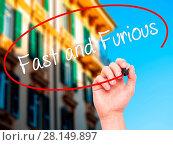 Купить «Man Hand writing Fast and Furious with black marker on visual screen», фото № 28149897, снято 13 декабря 2018 г. (c) easy Fotostock / Фотобанк Лори