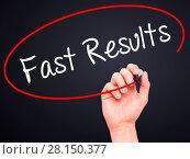 Купить «Man Hand writing Fast Results with black marker on visual screen», фото № 28150377, снято 18 июня 2019 г. (c) easy Fotostock / Фотобанк Лори