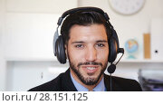 Купить «Portrait of a male employee with a headset», видеоролик № 28151125, снято 9 августа 2017 г. (c) Яков Филимонов / Фотобанк Лори
