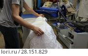 Купить «The wedding dress is ironed», видеоролик № 28151829, снято 22 апреля 2018 г. (c) Евгений Ткачёв / Фотобанк Лори