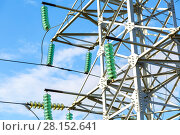 Купить «High voltage electric tower against the blue sky. Power transmission line», фото № 28152641, снято 8 октября 2017 г. (c) FotograFF / Фотобанк Лори