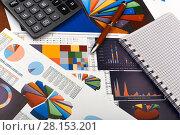 Купить «Калькулятор, графики и диаграммы. Бизнес-натюрморт», эксклюзивное фото № 28153201, снято 11 марта 2018 г. (c) Юрий Морозов / Фотобанк Лори