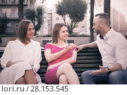 Купить «Young male is acquaintance with girls who are sitting on bench», фото № 28153545, снято 18 октября 2017 г. (c) Яков Филимонов / Фотобанк Лори
