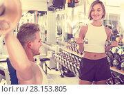 Купить «Woman making biceps curls», фото № 28153805, снято 13 декабря 2019 г. (c) Яков Филимонов / Фотобанк Лори