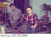 Купить «Portrait of adult female working near vise», фото № 28153889, снято 10 октября 2017 г. (c) Яков Филимонов / Фотобанк Лори