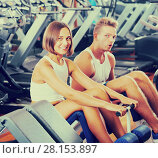 Купить «Well trained positive young man and woman training abdominal muscles in gym», фото № 28153897, снято 4 октября 2016 г. (c) Яков Филимонов / Фотобанк Лори
