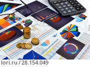 Купить «Калькулятор, таблицы, графики и диаграммы. Бизнес-натюрморт», эксклюзивное фото № 28154049, снято 11 марта 2018 г. (c) Юрий Морозов / Фотобанк Лори