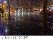 Купить «Сильный дождь в городе. Париж, бульвар Осман, вечер, декабрь», фото № 28154241, снято 10 декабря 2017 г. (c) Сергей Рыбин / Фотобанк Лори
