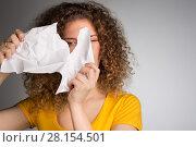 Купить «woman furiously tore the paper», фото № 28154501, снято 29 января 2018 г. (c) Типляшина Евгения / Фотобанк Лори