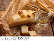 Купить «Сыр грюйер на деревянном фоне», фото № 28155097, снято 3 марта 2018 г. (c) Марина Володько / Фотобанк Лори