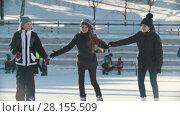 Portrait of three teenage girls wearing winter clothes at the rink. Стоковое видео, видеограф Константин Шишкин / Фотобанк Лори