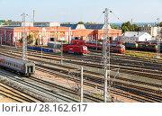 Купить «View on the railway track with train and railway depot at the Samara railway station», фото № 28162617, снято 16 сентября 2017 г. (c) FotograFF / Фотобанк Лори