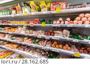 Купить «Different meat and sausage ready for sale in the supermarket Pyaterochka», фото № 28162685, снято 3 сентября 2017 г. (c) FotograFF / Фотобанк Лори