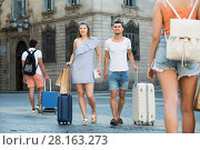Купить «Young man and woman in shorts with luggage», фото № 28163273, снято 22 июня 2017 г. (c) Яков Филимонов / Фотобанк Лори