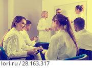 Купить «Medical students communicating during recess between lectures in auditorium», фото № 28163317, снято 5 октября 2017 г. (c) Яков Филимонов / Фотобанк Лори