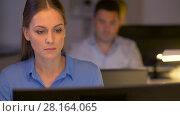 Купить «businesswoman at computer working at night office», видеоролик № 28164065, снято 18 декабря 2017 г. (c) Syda Productions / Фотобанк Лори