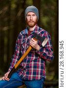 Купить «Bearded woodcutter with ax posing in forest», фото № 28168945, снято 1 мая 2017 г. (c) Константин Лабунский / Фотобанк Лори