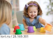 Купить «Child in kindergarten», фото № 28169301, снято 19 сентября 2018 г. (c) Оксана Кузьмина / Фотобанк Лори