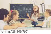 Купить «Girl discussing about mathematical formulas», фото № 28169797, снято 12 октября 2017 г. (c) Яков Филимонов / Фотобанк Лори