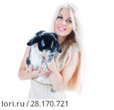 Купить «Cute blonde in dress holds funny black rabbit isolated on white», фото № 28170721, снято 20 ноября 2015 г. (c) Losevsky Pavel / Фотобанк Лори
