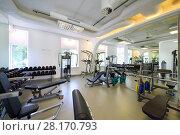 Купить «Empty modern gym with new shiny fitness equipment, dumbbell set for sport training», фото № 28170793, снято 29 июня 2016 г. (c) Losevsky Pavel / Фотобанк Лори
