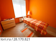 Купить «Empty orange room with table for massage, aromatherapy and relaxation», фото № 28170821, снято 29 июня 2016 г. (c) Losevsky Pavel / Фотобанк Лори