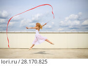 Купить «Beautiful gymnast in white jumping with red curly tape on the roof of a multistory building», фото № 28170825, снято 30 июля 2015 г. (c) Losevsky Pavel / Фотобанк Лори