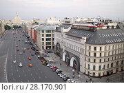 Купить «RUSSIA, MOSCOW - 30 JUL, 2015: Cityscape of a beautiful buildings and highway with many cars at the parking near hotel Nikolskaya», фото № 28170901, снято 30 июля 2015 г. (c) Losevsky Pavel / Фотобанк Лори