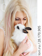 Купить «Cute blonde hugs and fluffy white rabbit in white room, close up», фото № 28170905, снято 20 ноября 2015 г. (c) Losevsky Pavel / Фотобанк Лори