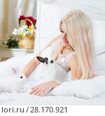 Купить «Blonde in bride white dress plays with two funny fluffy cubs of rabbit on bed», фото № 28170921, снято 20 ноября 2015 г. (c) Losevsky Pavel / Фотобанк Лори