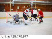 Купить «MOSCOW - SEP 5, 2016: Nonpro players play hockey in ice palace in Novokosino», фото № 28170977, снято 5 сентября 2016 г. (c) Losevsky Pavel / Фотобанк Лори