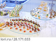 Купить «Many different canapes - cold appetizers are on table with white cloth», фото № 28171033, снято 25 октября 2016 г. (c) Losevsky Pavel / Фотобанк Лори