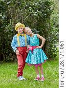 Купить «Boy and girl dressed in bright dancing suits pose at grassy lawn», фото № 28171061, снято 10 сентября 2016 г. (c) Losevsky Pavel / Фотобанк Лори