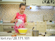 Купить «Pretty girl in apron prepares course with mixer in modern kitchen at home», фото № 28171101, снято 22 марта 2016 г. (c) Losevsky Pavel / Фотобанк Лори