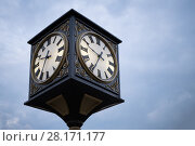 Купить «Beautiful old style street clock during overcast evening, cloudy sky», фото № 28171177, снято 3 июля 2016 г. (c) Losevsky Pavel / Фотобанк Лори