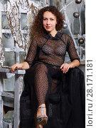 Купить «Pretty smiling woman in transparent dress sits in white stylish studio», фото № 28171181, снято 27 ноября 2015 г. (c) Losevsky Pavel / Фотобанк Лори