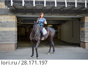 Купить «Woman on horseback in front of entrance to underground parking», фото № 28171197, снято 5 июля 2016 г. (c) Losevsky Pavel / Фотобанк Лори