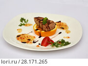 Купить «Piece of roasted meat on orange slice on plate decorated with tomatoes, greens and sauce», фото № 28171265, снято 7 июля 2016 г. (c) Losevsky Pavel / Фотобанк Лори