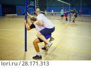 Купить «MOSCOW - SEP 13, 20616: Alexey Serikov trains volleyball team in gym of Moscow University of Technology», фото № 28171313, снято 28 мая 2018 г. (c) Losevsky Pavel / Фотобанк Лори