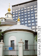 Купить «Old church Cosmas and Damian and tall building in Moscow, Russia at summer», фото № 28171321, снято 10 июля 2016 г. (c) Losevsky Pavel / Фотобанк Лори