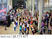 Купить «MOSCOW - APR 16, 2016: Many women dance on fitness workout in DI Telegraph. Everyone will be able to exercise free of charge at Reebok sites in Moscow park», фото № 28171477, снято 16 апреля 2016 г. (c) Losevsky Pavel / Фотобанк Лори