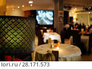 Купить «Lampshade and people sitting in restaurant, at evening, focus on lamp», фото № 28171573, снято 16 апреля 2016 г. (c) Losevsky Pavel / Фотобанк Лори