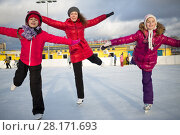 Купить «Three of young woman and little girls are standing on the one foot at rink, focus on woman», фото № 28171693, снято 3 января 2015 г. (c) Losevsky Pavel / Фотобанк Лори