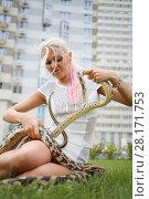 Купить «Pretty woman with two snakes on green lawn near building at summer», фото № 28171753, снято 18 июля 2016 г. (c) Losevsky Pavel / Фотобанк Лори